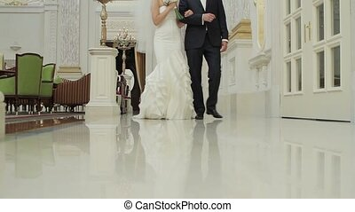 Bride and groom in a beautiful palace Newlyweds walk in the...