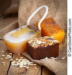 honey handmade soap, on wooden background
