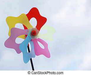 toy windmill - colorful toy windmill isoltaed on a dull blue...