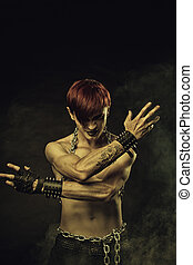Ritual - Redhead gothic man posing over dark background