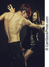 Gothic dance - Redhead gothic man with beautiful lady in...