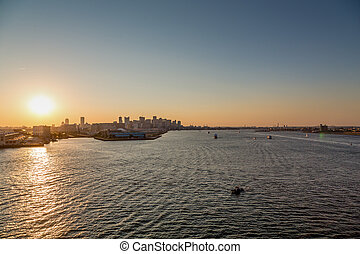 Sunset on Boston Harbor - Skyline of Boston from the sea at...