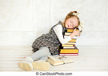 a little the girl with books - education and school concept...