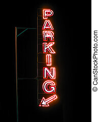 Parking sign neon light at night over dark sky