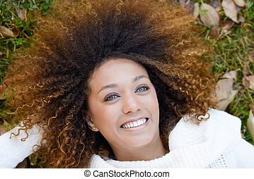 Young African American girl with afro hairstyle and green...