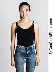 Young woman wearing black tank top and blue jeans on white...