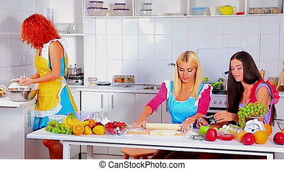 Young happy family cooking at kitchen. - Group of young...