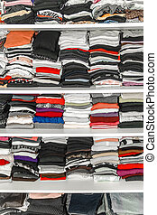 Dressing White Closet with Clothes Arranged Neatly Thickly Ordered
