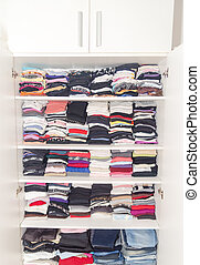 Dressing White Closet with Clothes Arranged Neatly Thickly...