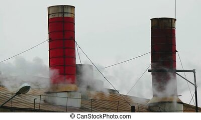 Old factory roof with red chimney
