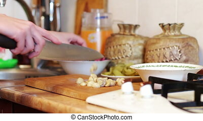 Cooking, Cutting Mushrooms in the Kitchen - Woman cook in...