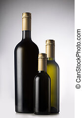 Different wine bottles with pilfers - Wine bottles in...