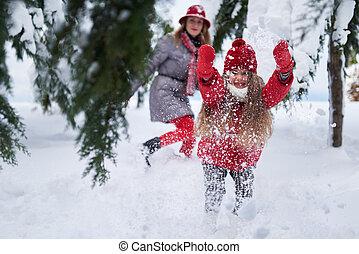 girl provokes play   snow