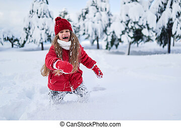 child with all the forces running through snow and laughing