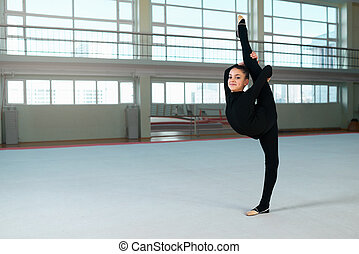 beautiful gymnastic girl makes balance - beautiful girl in...