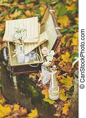 Decorated bottle with flowers and notes on the fall foliage...