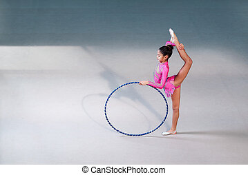 gymnast in a beautiful suit doing hoop exercise - gymnast in...