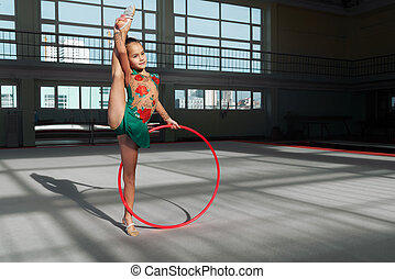 Little girl doing exercise with hoop Shadows on floor