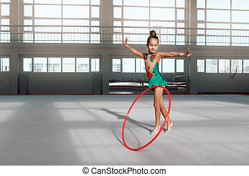 girl in dress dancing with hoop gym-hall - Little girl in...