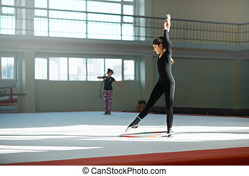 Girl practicing rhythmic gymnastics hoop - beautiful girl...