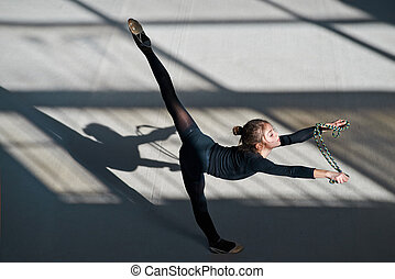 girl making balance rope rhythmic gymnastics - girl making a...