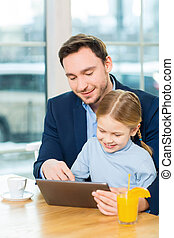 Shot of nice father and cute daughter using tablet - Make it...