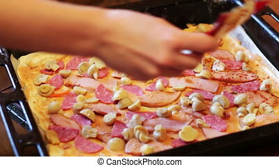 Making Pizza at Home - Woman cook preparing a pizza in the...