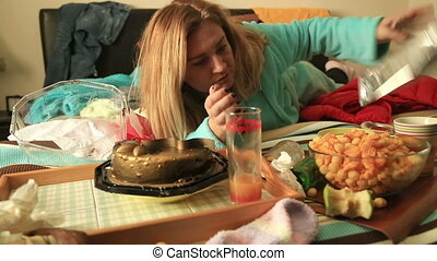 Depressive woman eating cake - Portrait of a woman in...