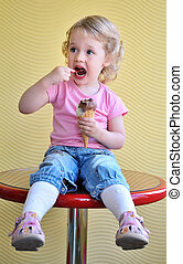 girl and ice cream - little funny blonde girl eating big ice...