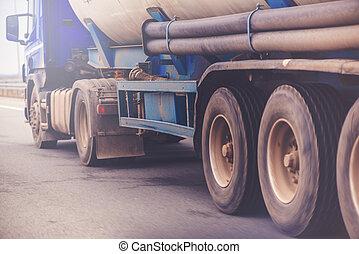 Commercial trailer truck in motion on freeway, cargo...