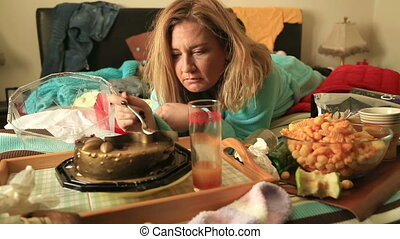 Depressive woman eating cake - Portrait of a lonely sad...