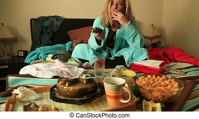 Depressive woman watching tv - Portrait of a unhappy,...