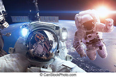 International Space Station with astronauts over the planet...