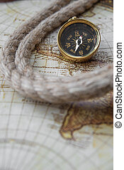 Compass and marine knot located on the background of old map