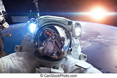 International Space Station with astronaut over the planet...