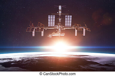 International Space Station over the planet Earth Elements...