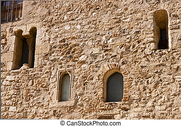 Facade with windows in the romanesque monastery of Sant Cugat
