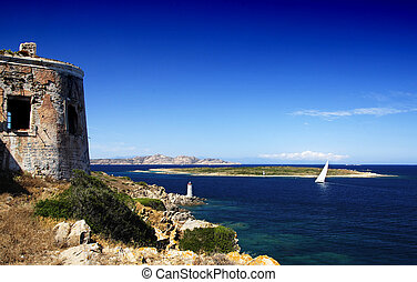 Yacht and lighthouse - Lighthouse on Sardinian rocks and a...