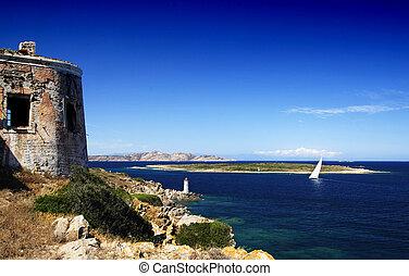 Yacht and lighthouse - Lighthouse on Sardinian rocks and a...