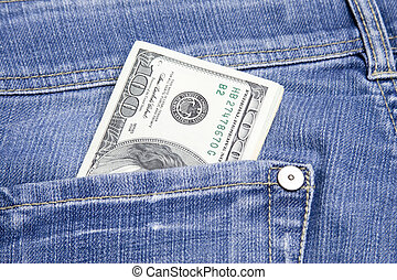 Money in the pocket - US 100, 20 and 10 dollar bills in his...