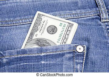 Money in the pocket - U.S. 100, 20 and 10 dollar bills in...