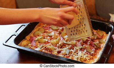 Cooking Home made Pizza - Woman cook preparing a pizza in...