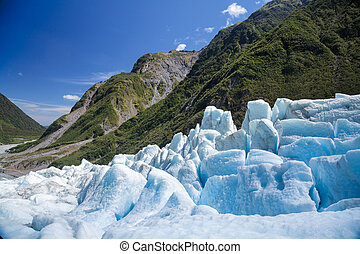 Blue ice of Fox Glacier in South Island of New Zealand -...