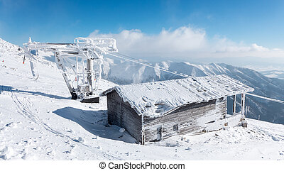 Old snowy cableway - Old ruined cableway in resort Jasna,...