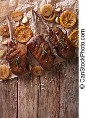 grilled beef steak with rosemary on a paper. vertical top view