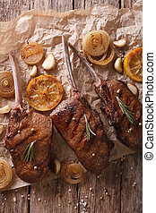 grilled beef steak with rosemary on a paper close-up. vertical top view