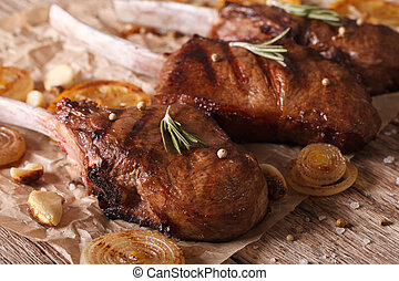 grilled beef steak with rosemary on a paper close-up...