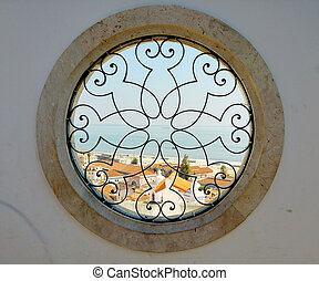 round windows with harbor view in lissabon - round art...