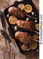 Beef steak with lemon on a grill pan close-up vertical top...