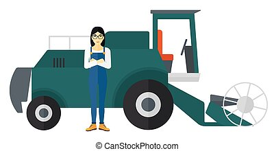Woman standing with combine on background - An asian woman...